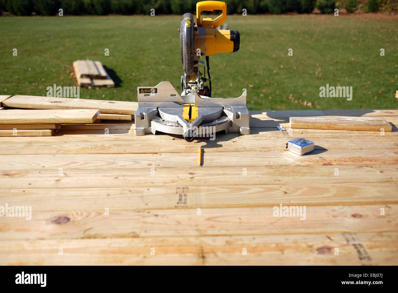 A miter saw, tape measure, pencil. Stock Photo