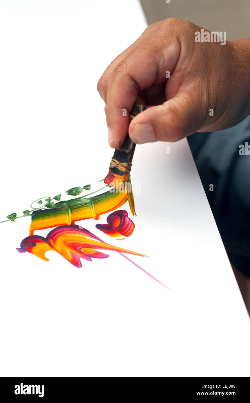 Italy, Street Artist Painting a Name in a Decorative Way Stock Photo