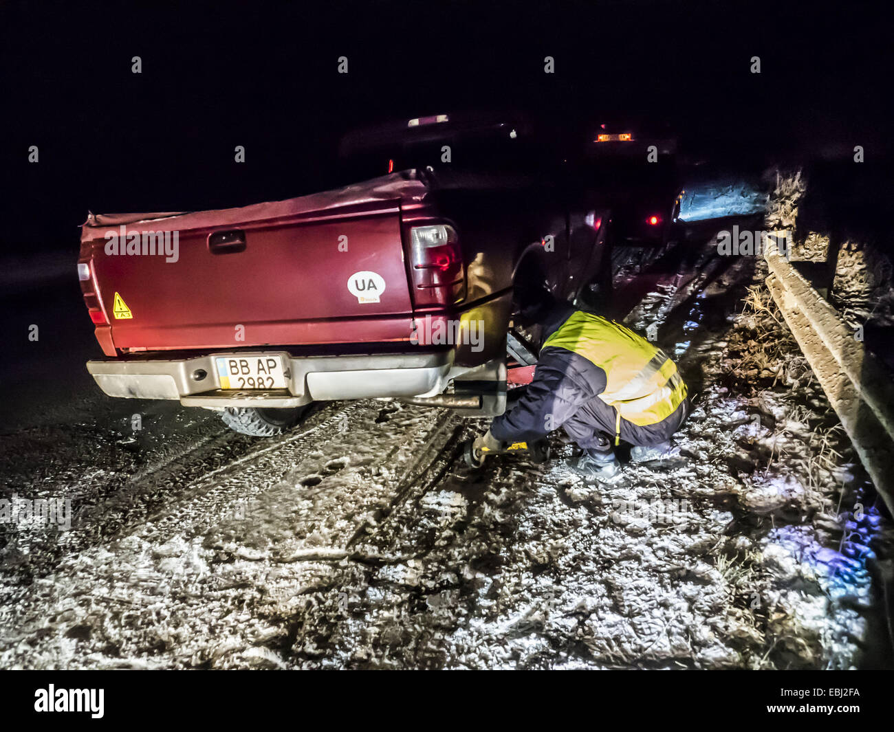 Truck Ford Ranger was evacuated after the breakdown on the winter road near Kiev, Ukraine. Due to delays in the - Stock Image