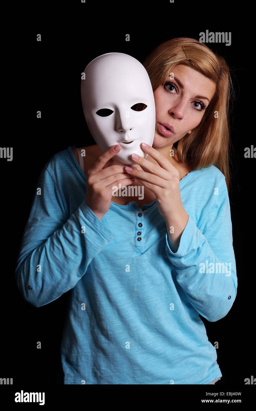 woman taking off mask - Stock Image
