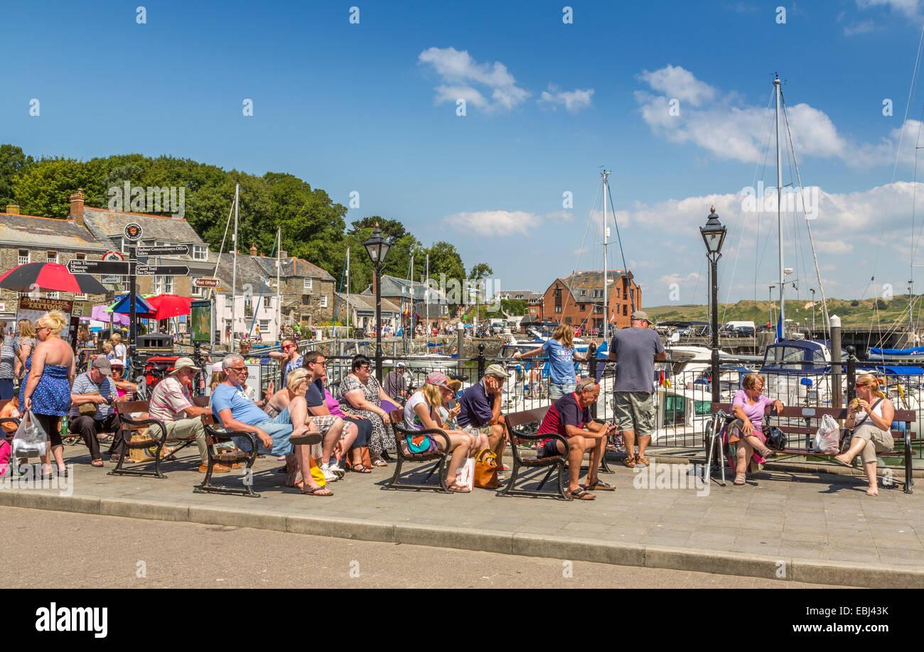 Tourists enjoying the summer sunshine in Padstow Cornwall England UK - Stock Image
