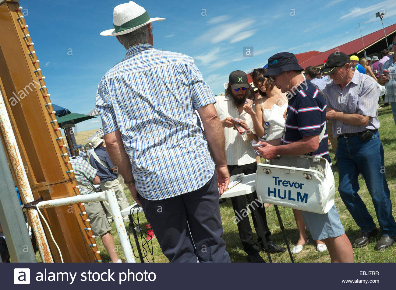 Bookies & punters at the Adaminaby Races (horse racing), in the Snowy Mountains, NSW, Australia. - Stock Image