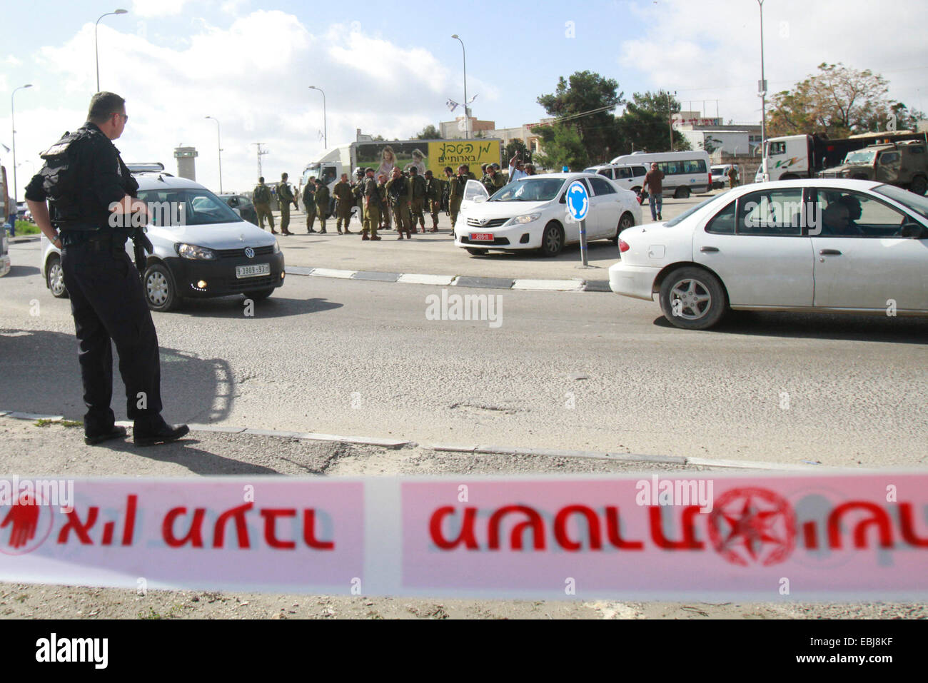 Israeli police carry out forensic work at the site of an alleged stabbing attack by a Palestinian woman on an Israeli - Stock Image