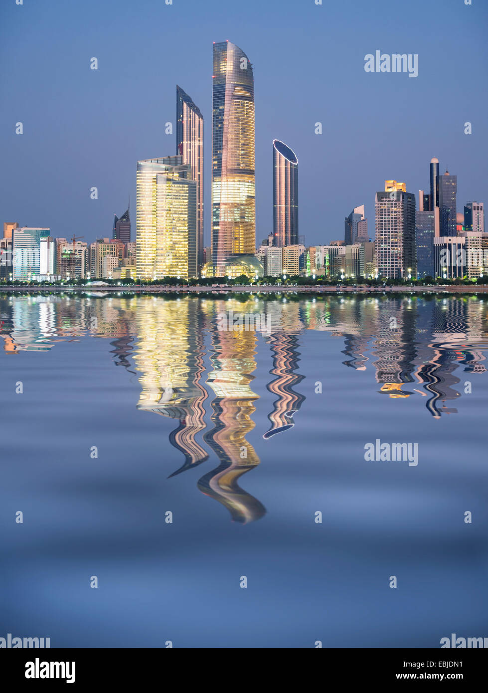Skyline and reflection of modern buildings along Corniche waterfront in Abu Dhabi United Arab Emirates - Stock Image