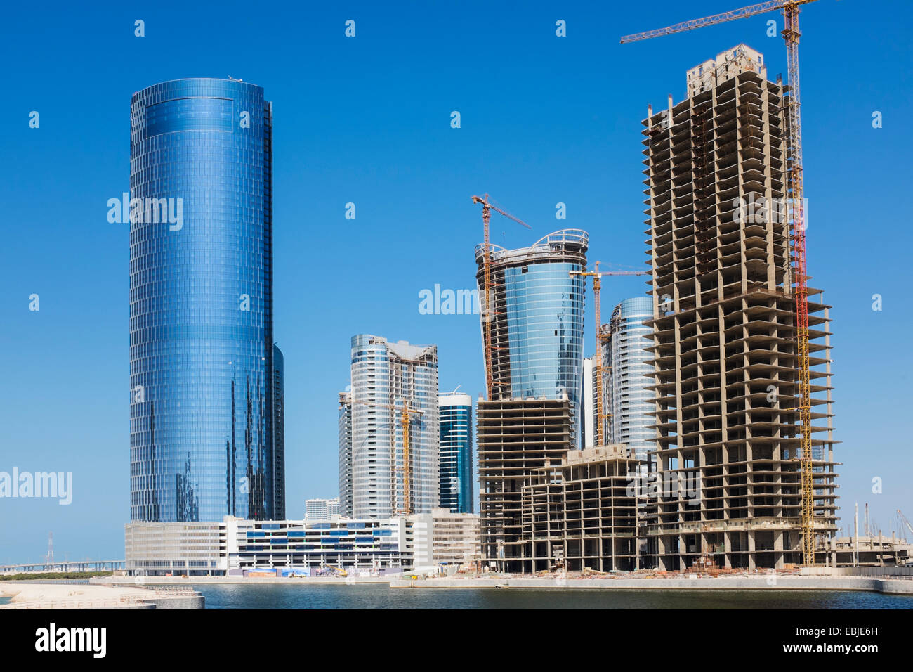 Modern high-rise residential and office buildings under construction at City of Lights on Al Reem Island in Abu - Stock Image