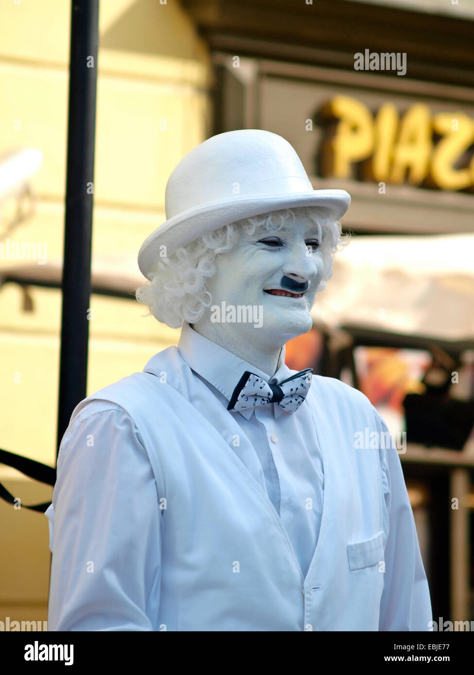 Lone street mime. - Stock Image