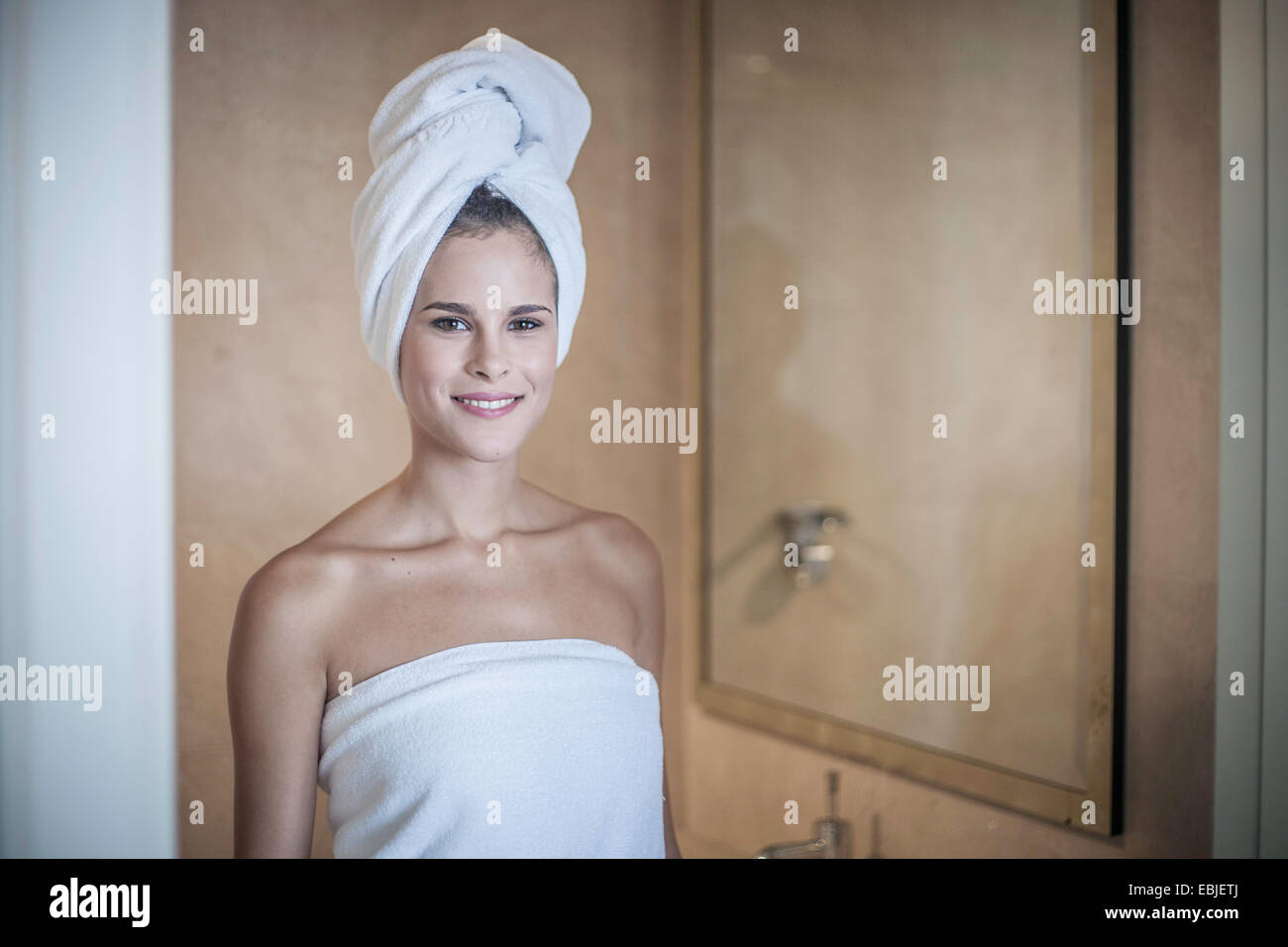 Young woman with towel on head - Stock Image
