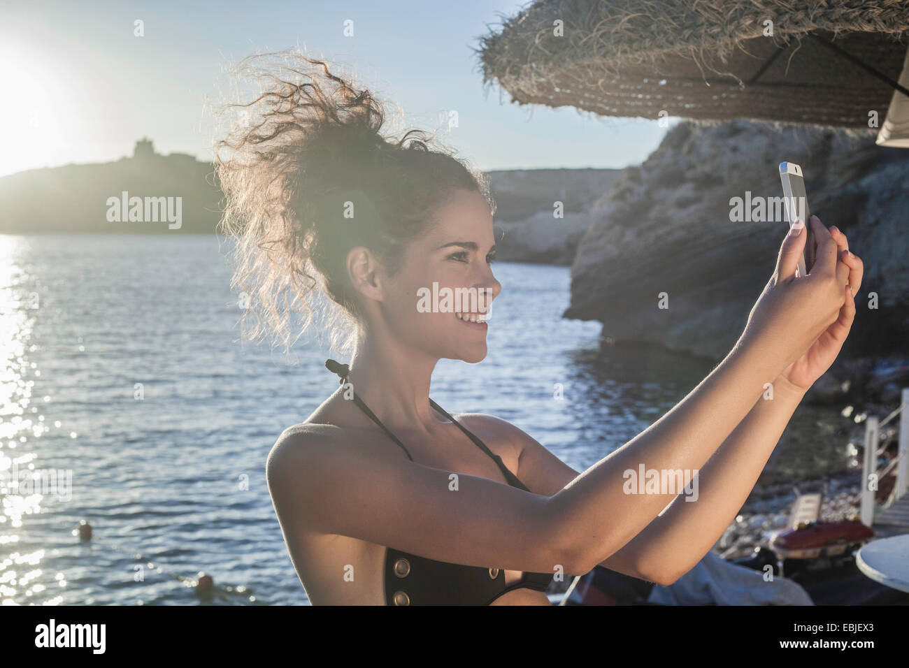 Young woman taking selfie - Stock Image