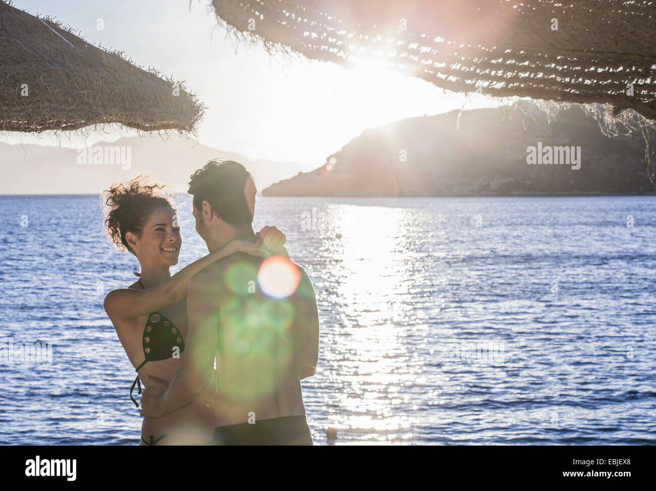 Couple embracing on vacation - Stock Image