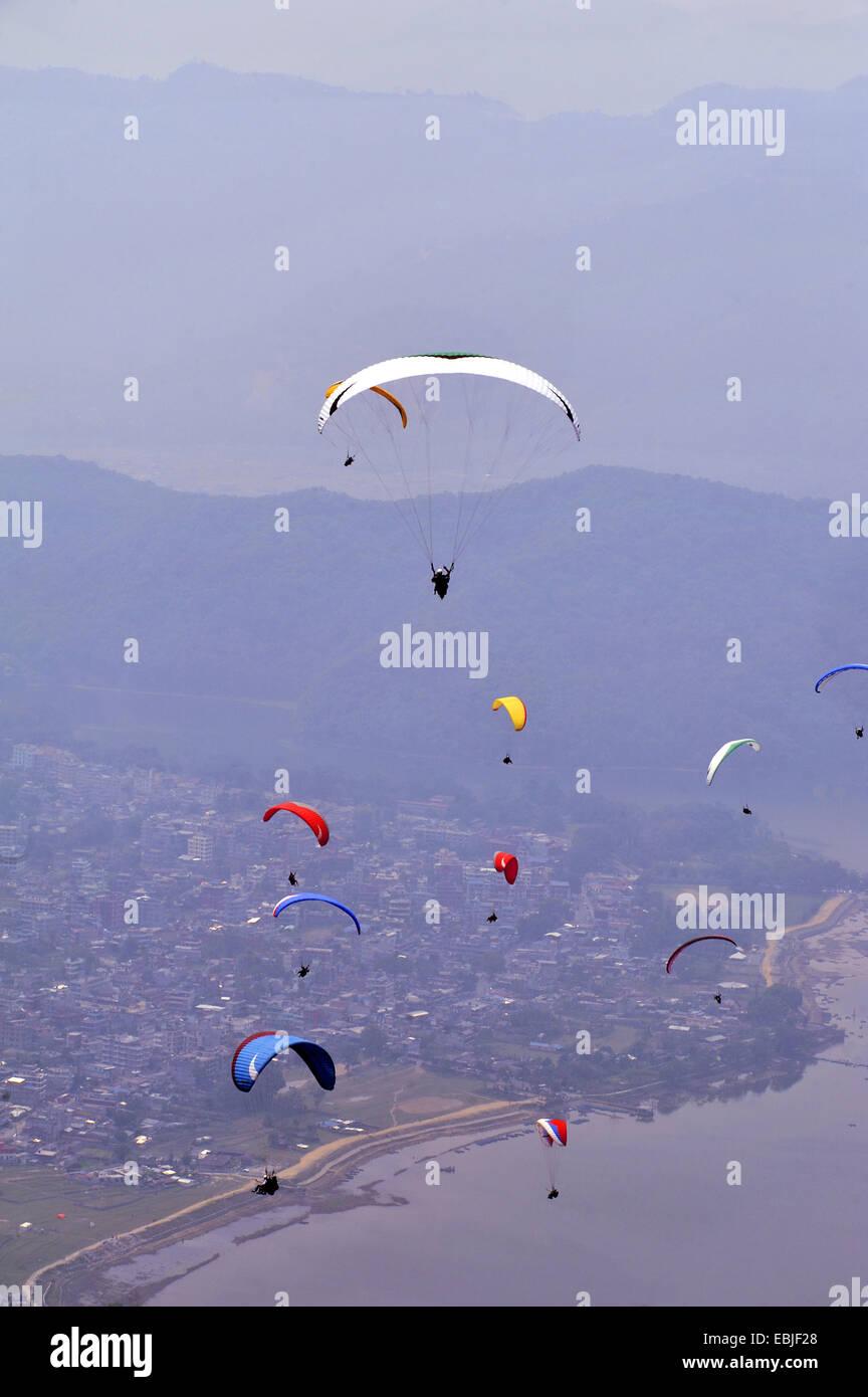 paraglidiers over Phewa Lake, Nepal, Pokhara - Stock Image
