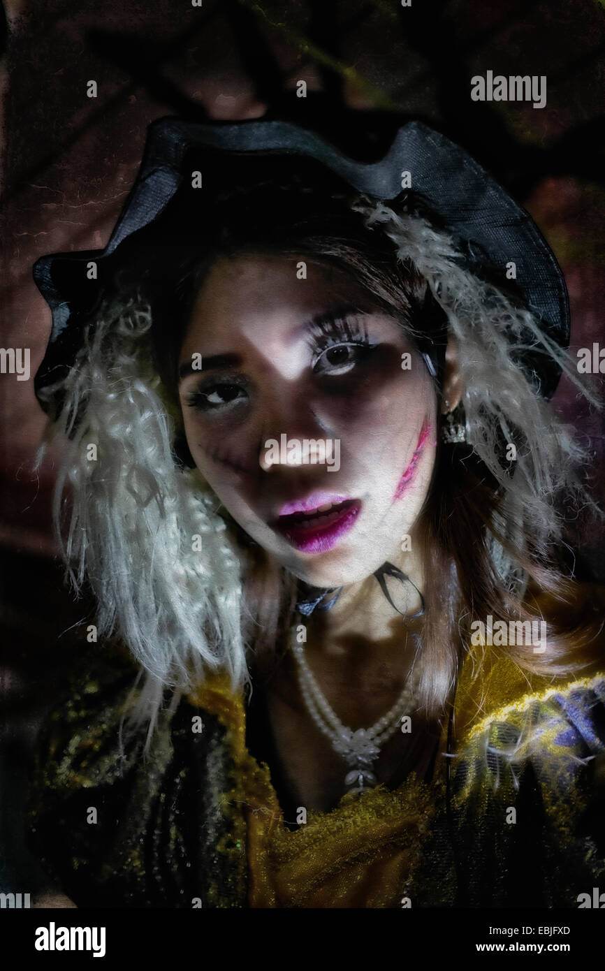 Halloween woman. Grunge and painterly effect of a Zombie female - Stock Image
