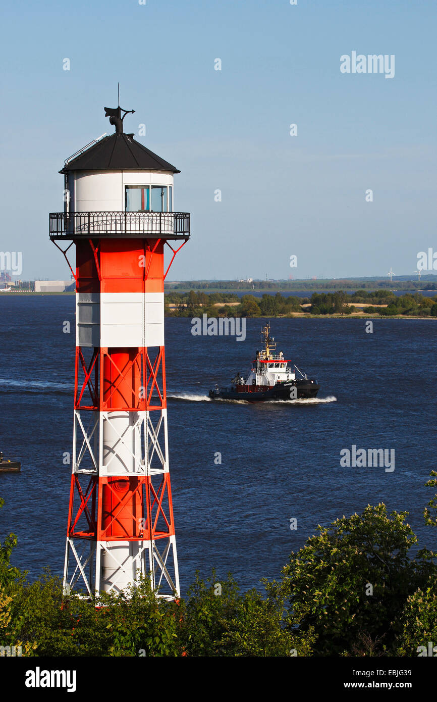 lighthouse and towboat in Wittenbergen, Germany, Hamburg - Stock Image