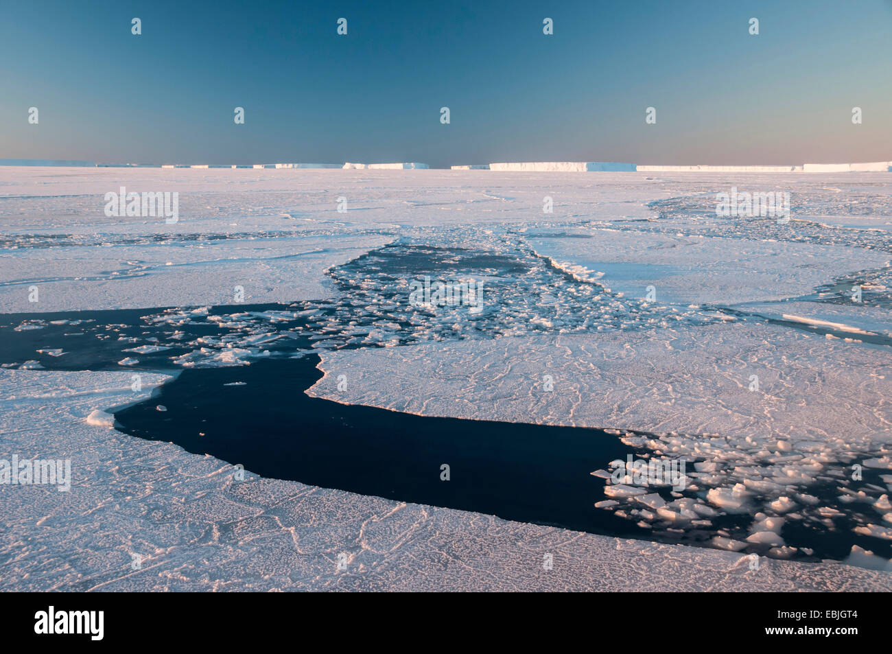 waterways through the pack ice field opened by icebreakers at extreme frost near the iceberg resting place Austasen - Stock Image