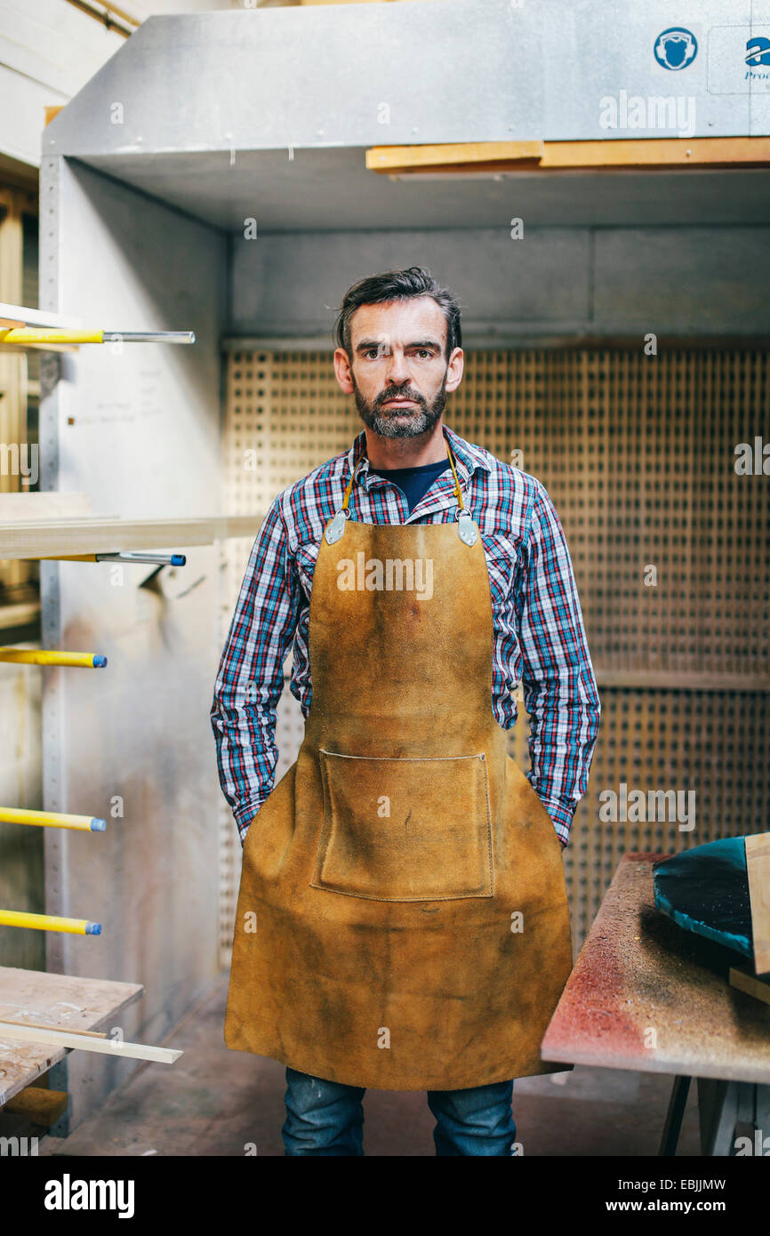 Portrait of mature craftsman in organ workshop Stock Photo