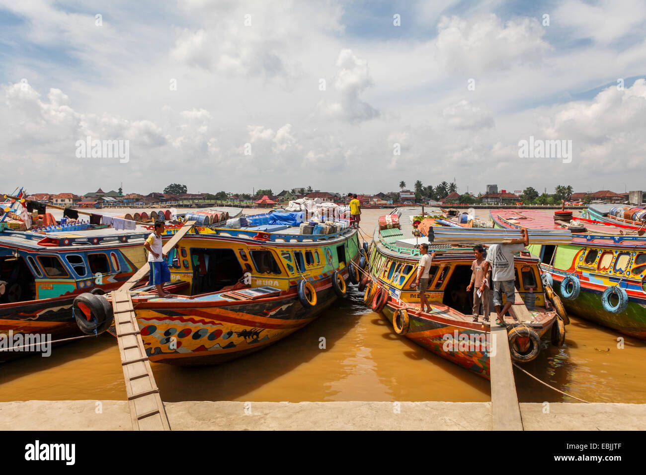 Wooden cargo boats on Musi River, South Sumatra, Indonesia. - Stock Image