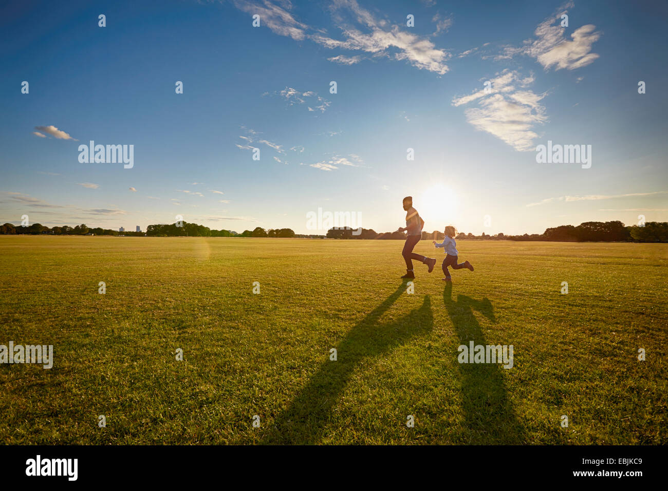 Father and son out in the park - Stock Image