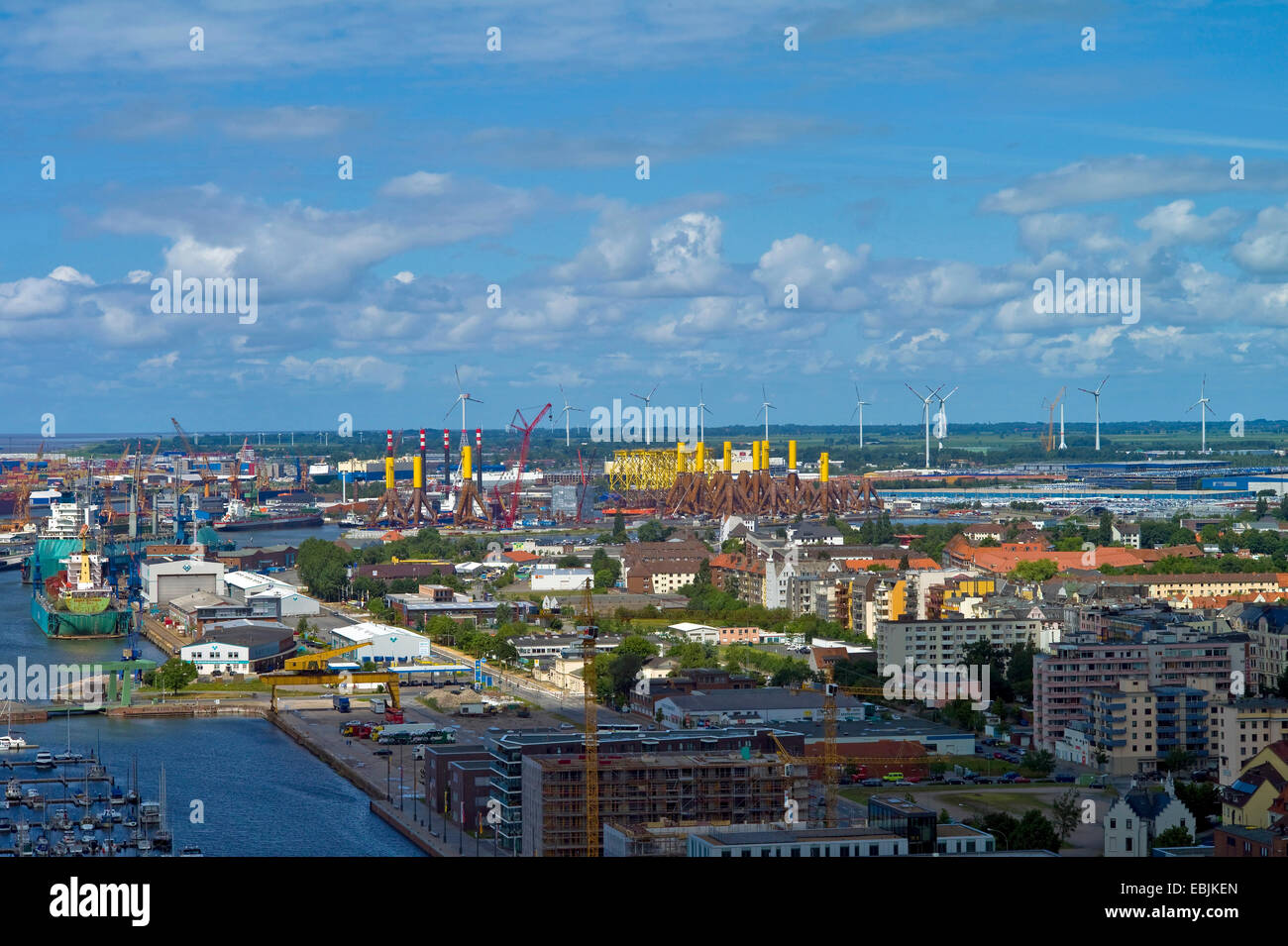 panoramic view over the harbours with tripods for windmills at the container port, Germany, Bremerhaven - Stock Image