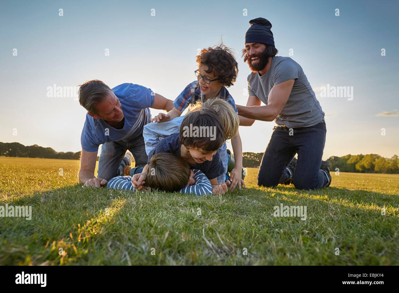 Family enjoying outdoor activities in the park - Stock Image