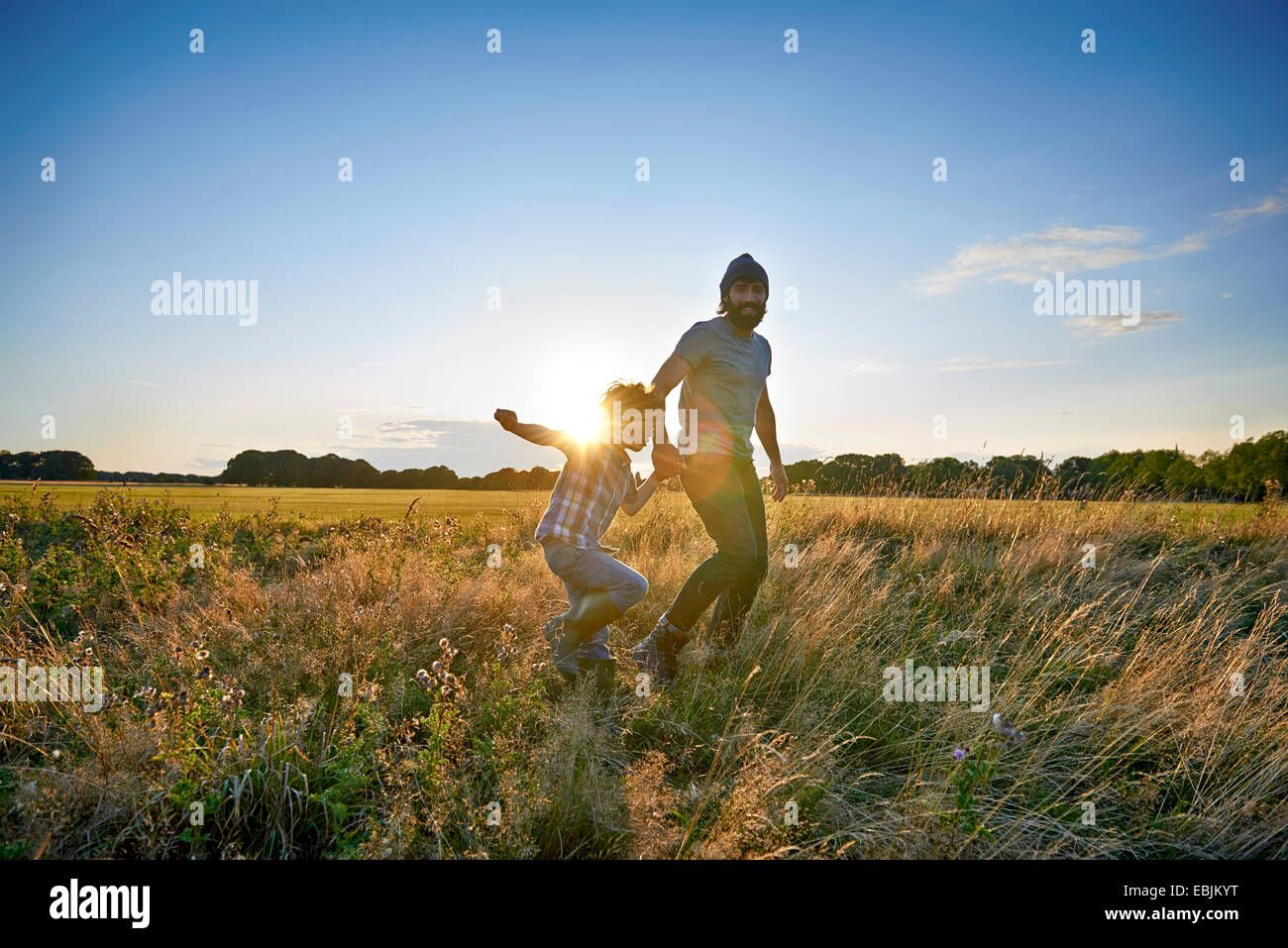 Father and son out walking in the park - Stock Image