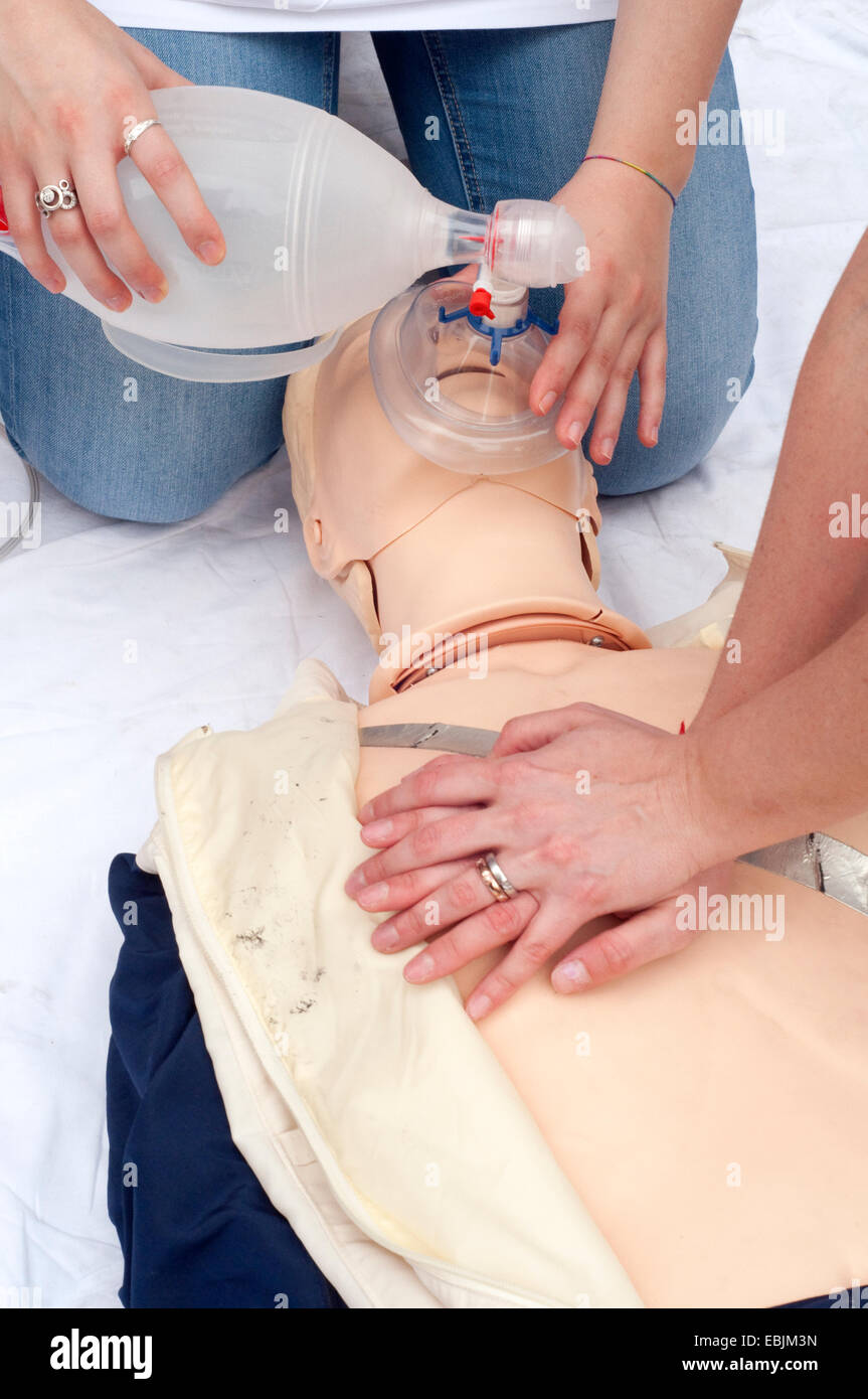 Paramedic Demonstrates Reanimation on Dummy Patient Simulated Mannequin - Stock Image