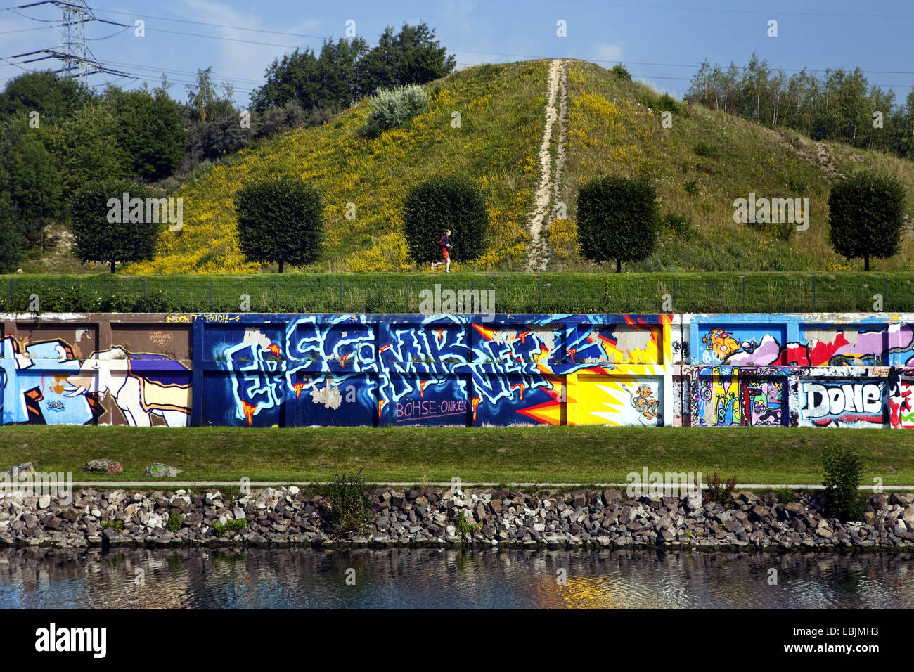 wall with graffitis at chanel Rhein Herne Kanal at Nordsternpark, Germany, North Rhine-Westphalia, Ruhr Area, Gelsenkirchen - Stock Image