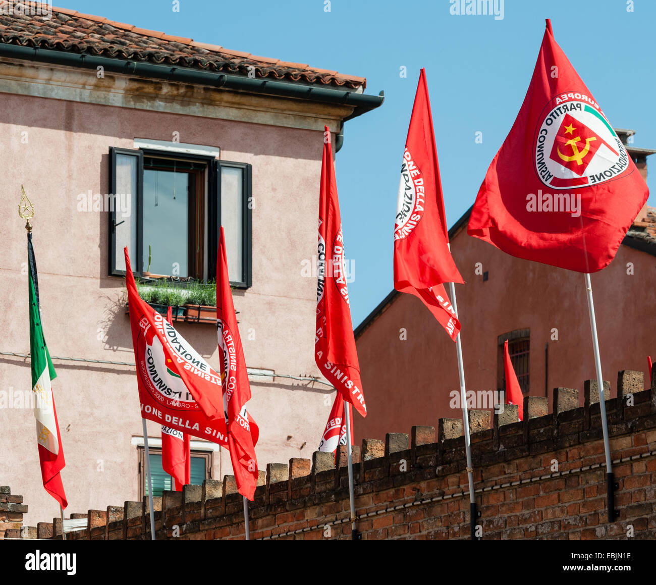 Venice, Italy. Italian Communist Party flags flying on May Day (International Workers' Day) - Stock Image