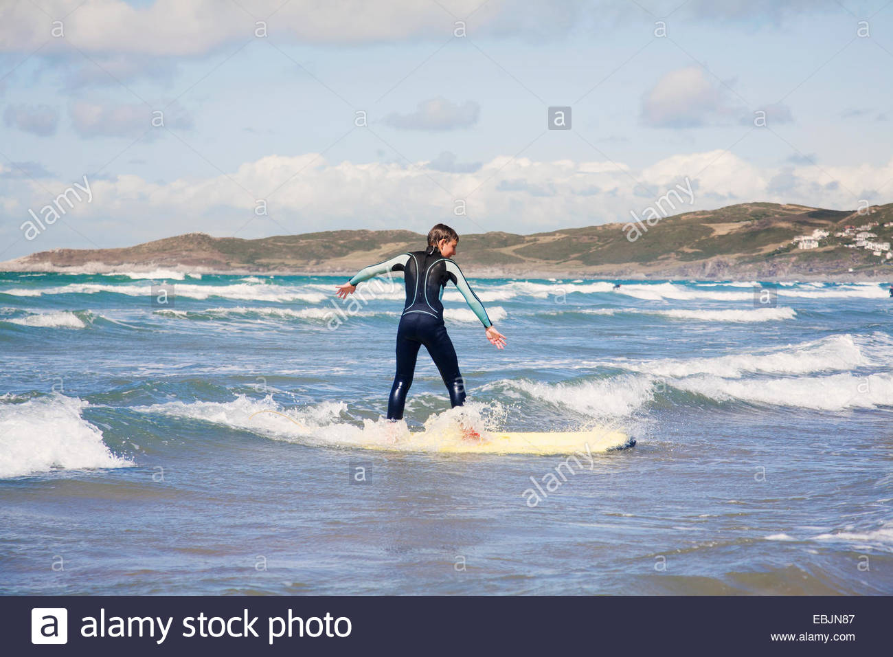 Boy surfing - Stock Image