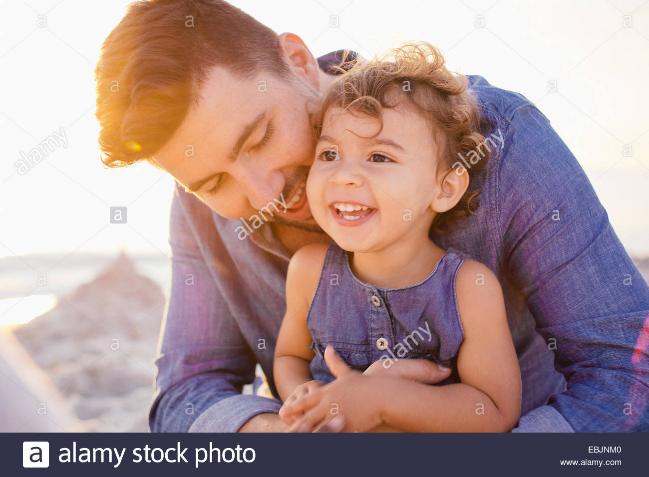 Portrait of father and toddler daughter at beach, Tuscany, Italy - Stock Image