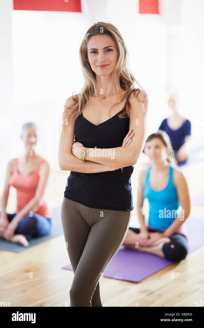 Portrait of female tutor in pilates class - Stock Image