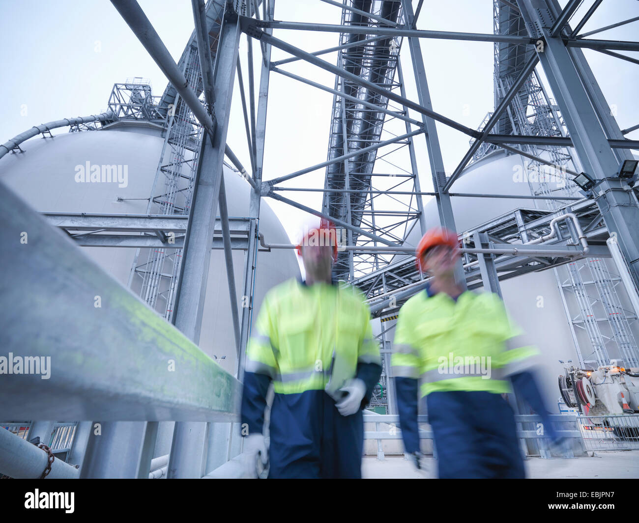 Workers walking towards camera at biomass facility Stock Photo