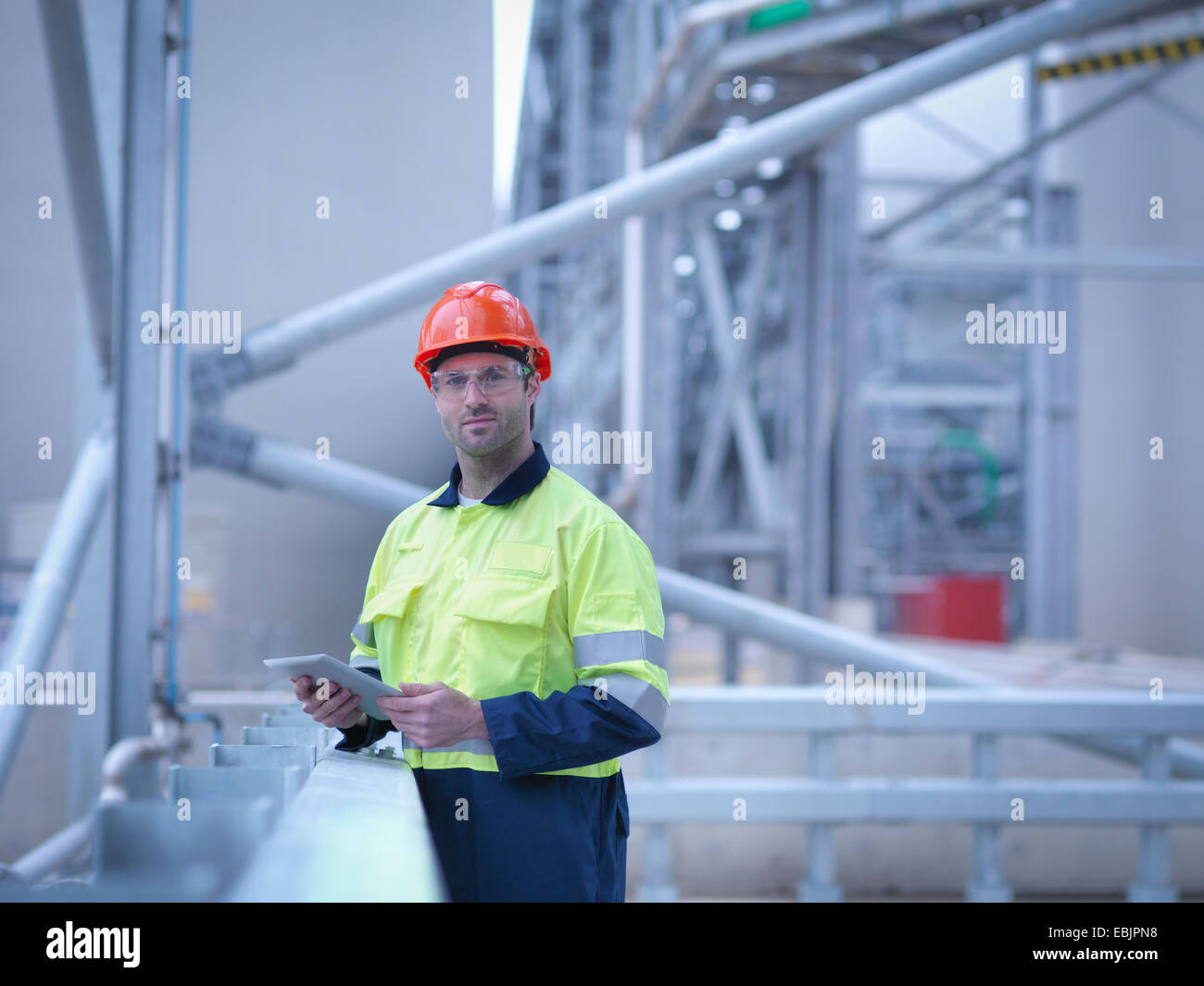 Portrait of worker holding digital tablet at biomass facility Stock Photo