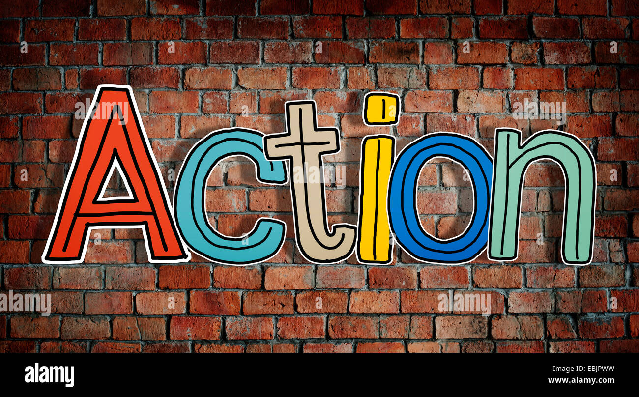 Action Word and Brick Wall in Background - Stock Image