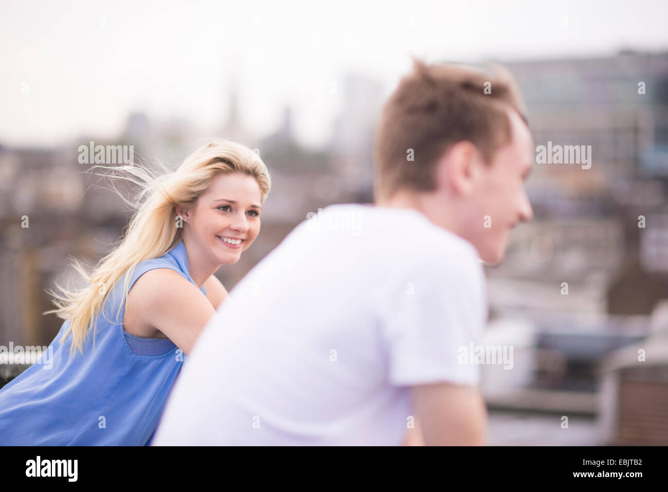 Couple, focus on young woman - Stock Image