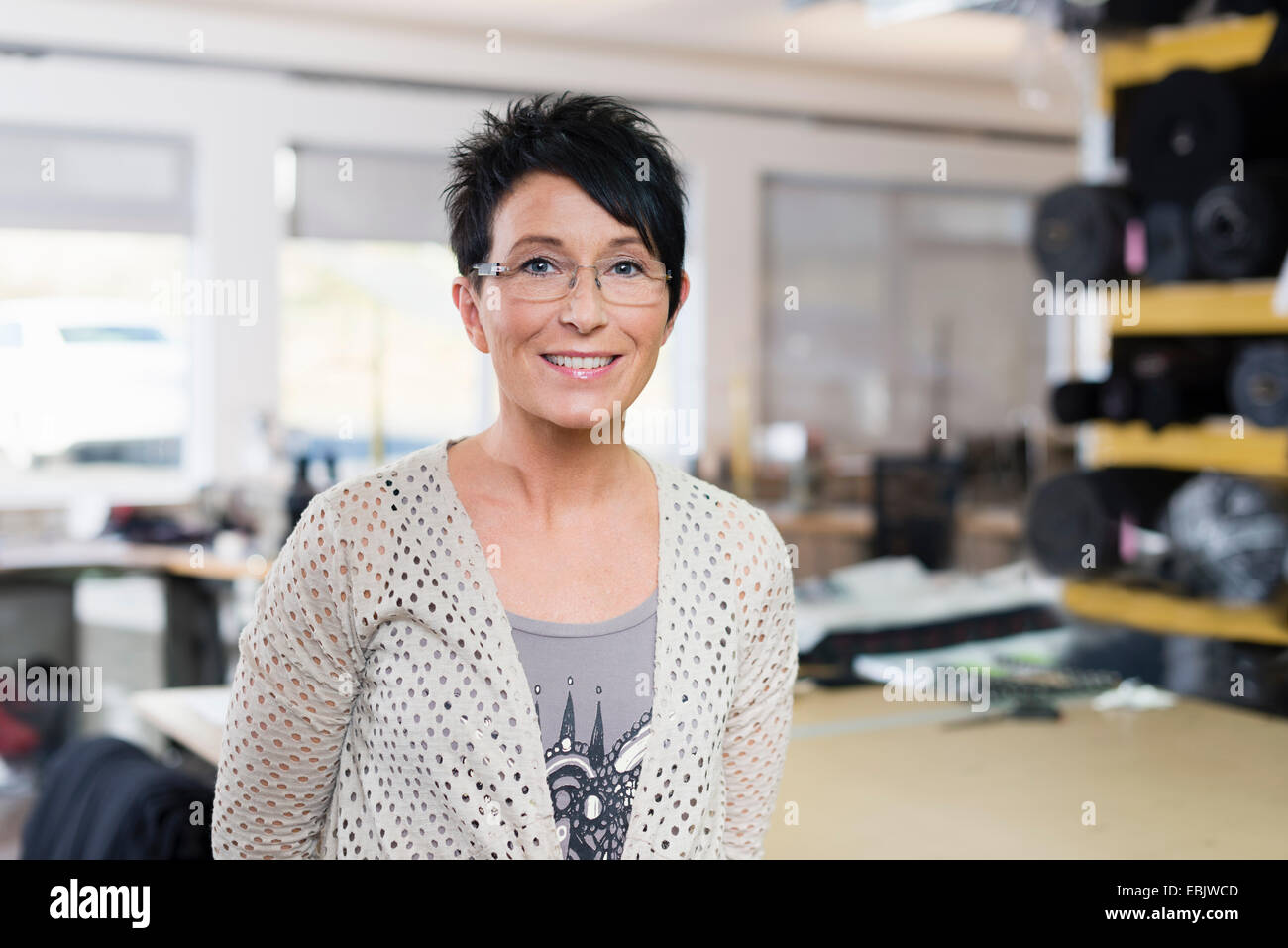 Portrait of mature seamstress in workshop Stock Photo