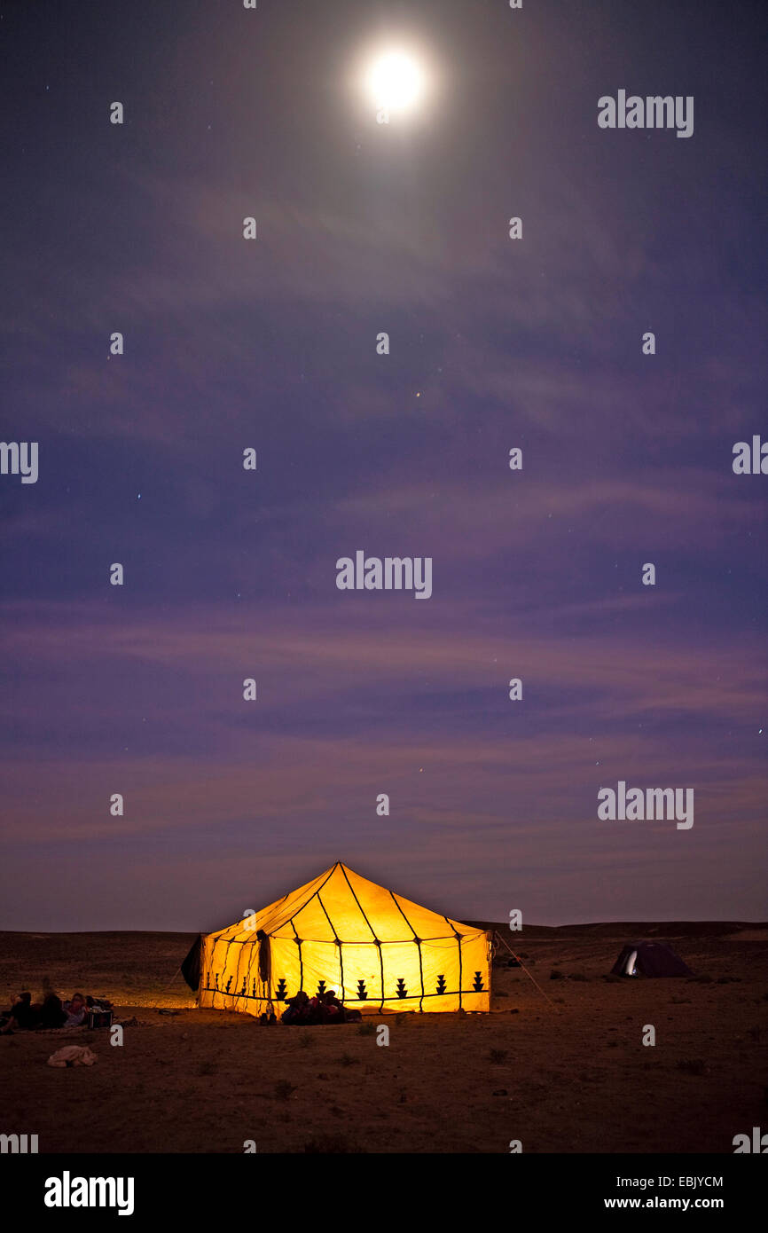 illuminated house tent at full moon in Sahara, Morocco, Souss-Massa-Dara� - Stock Image