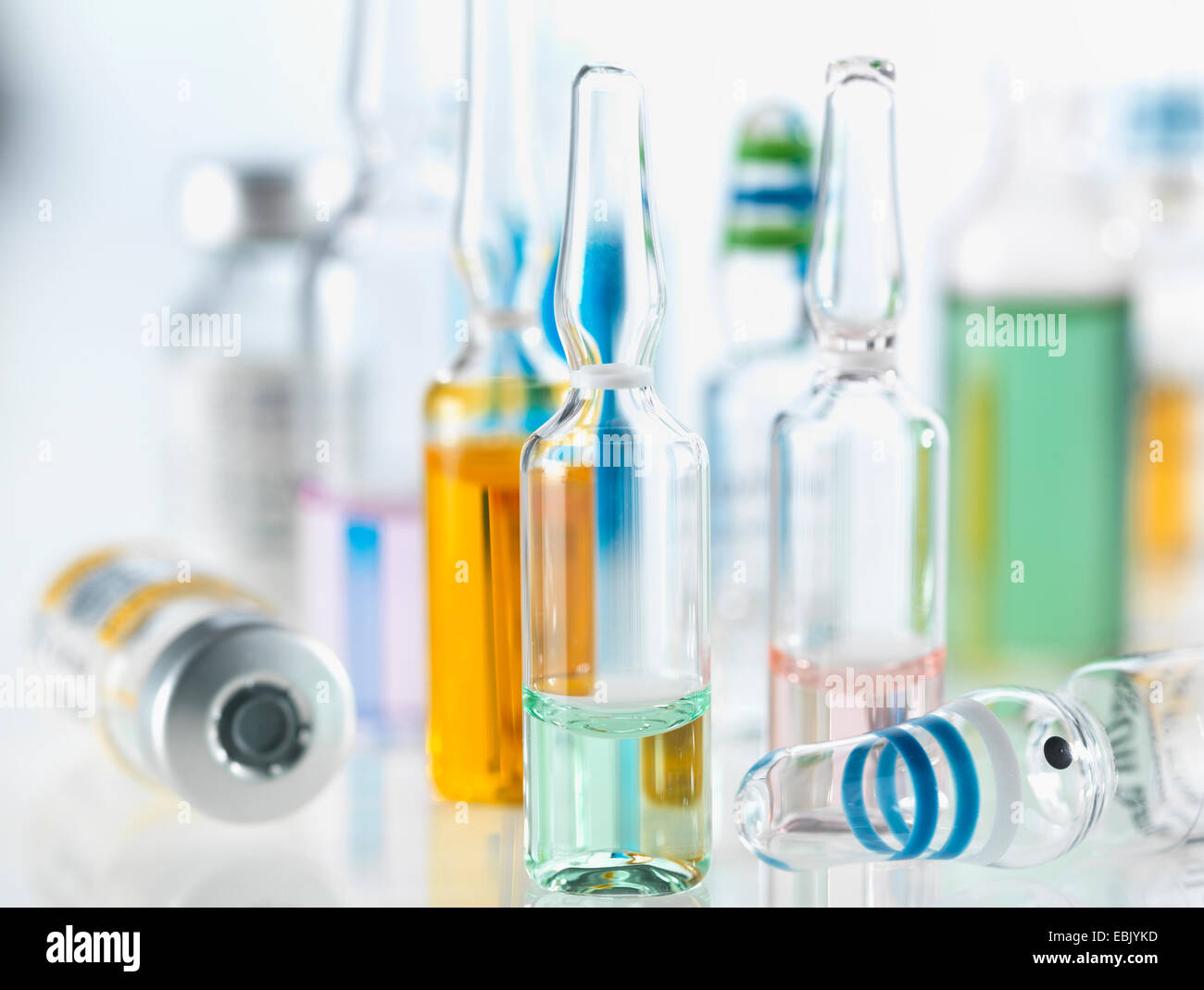 Variety of drugs including vials, ampules and vaccines illustrating medical research - Stock Image