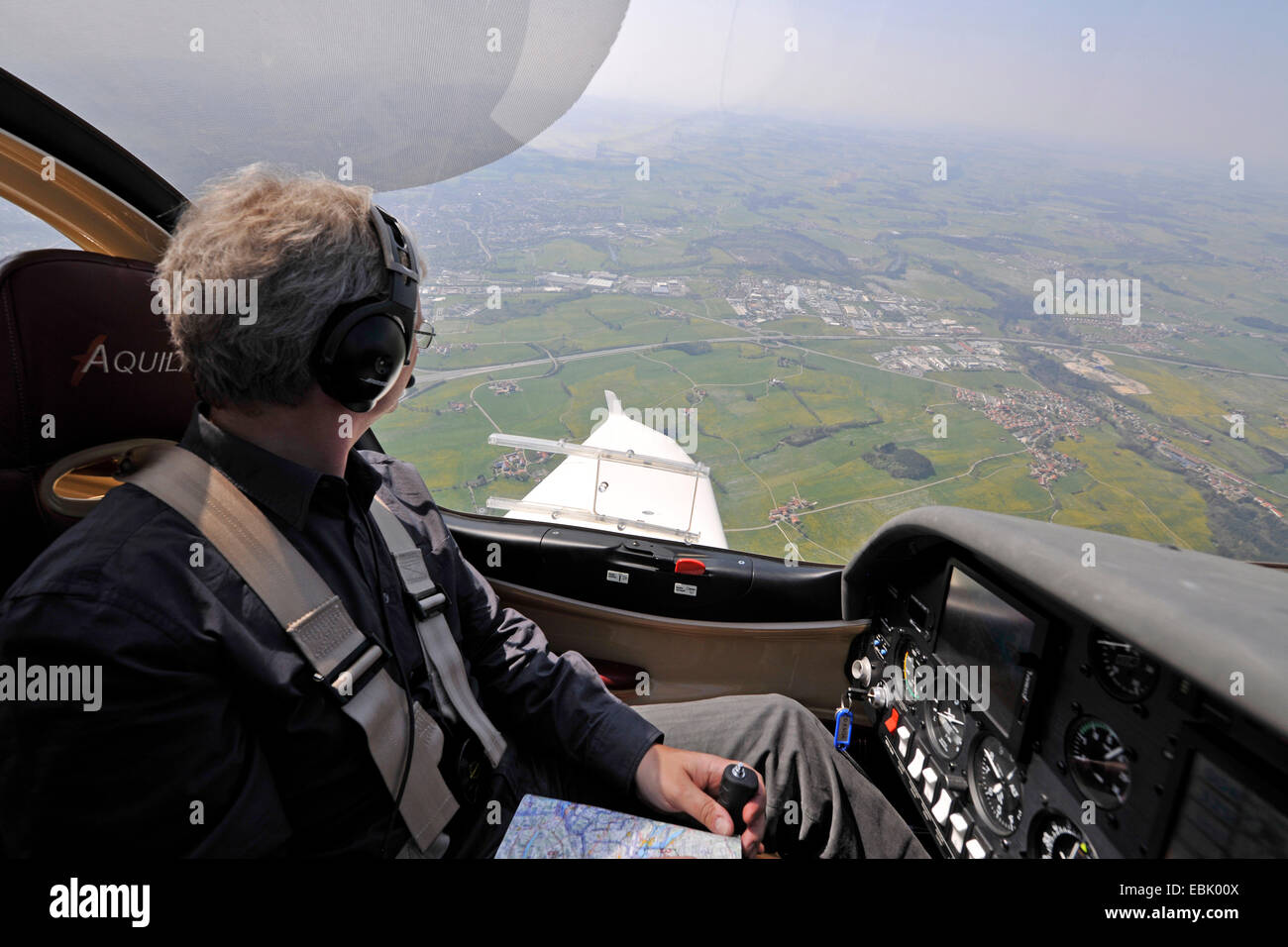 pilot in the glass cockpit of the small aircraft D-ESOA Aquila A210 AT01, Germany - Stock Image