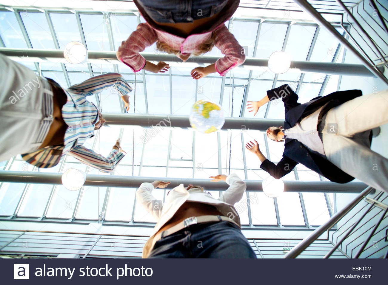 office workers playing with a ball at the office building - Stock Image
