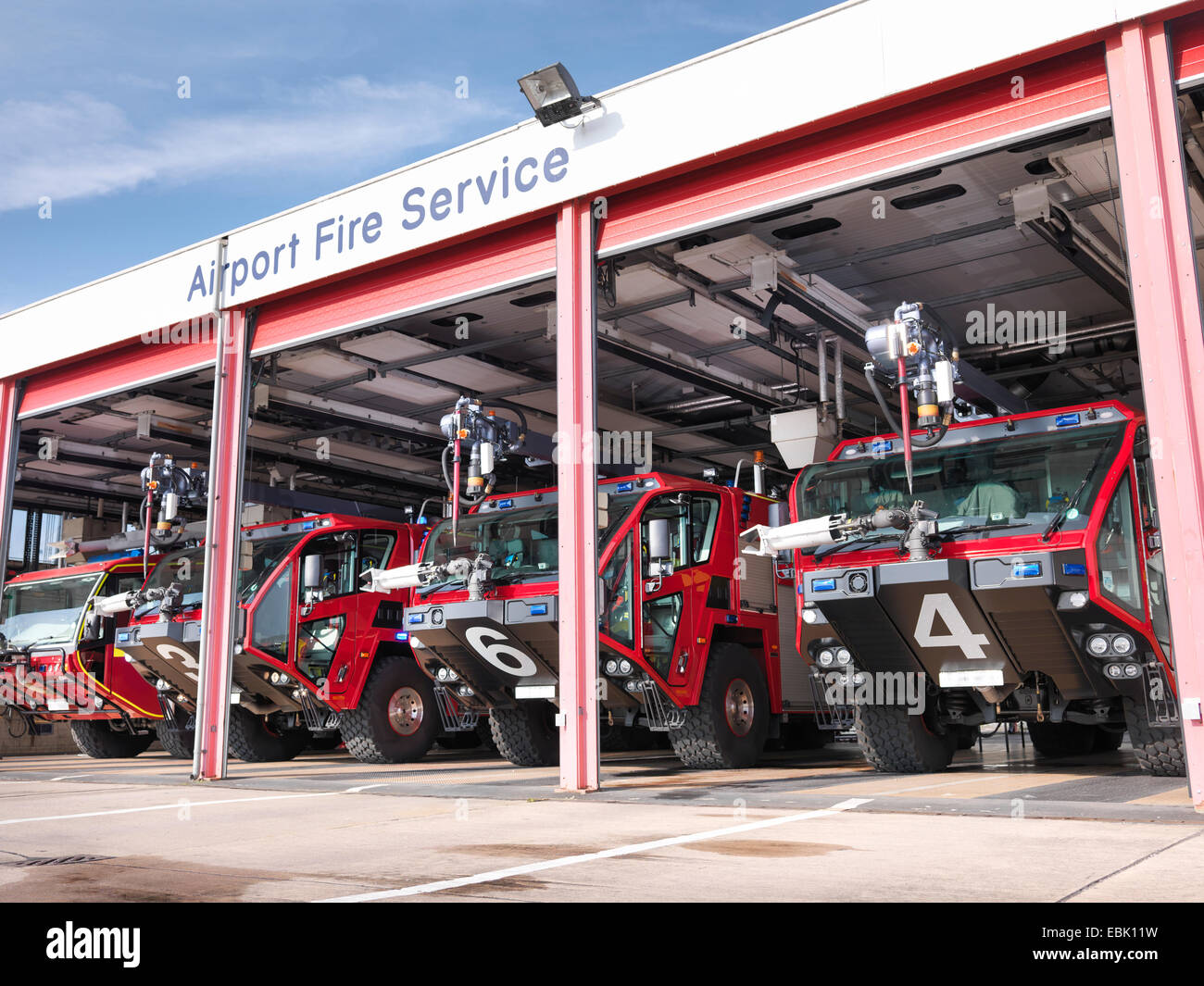 Fire engines in airport fire station - Stock Image