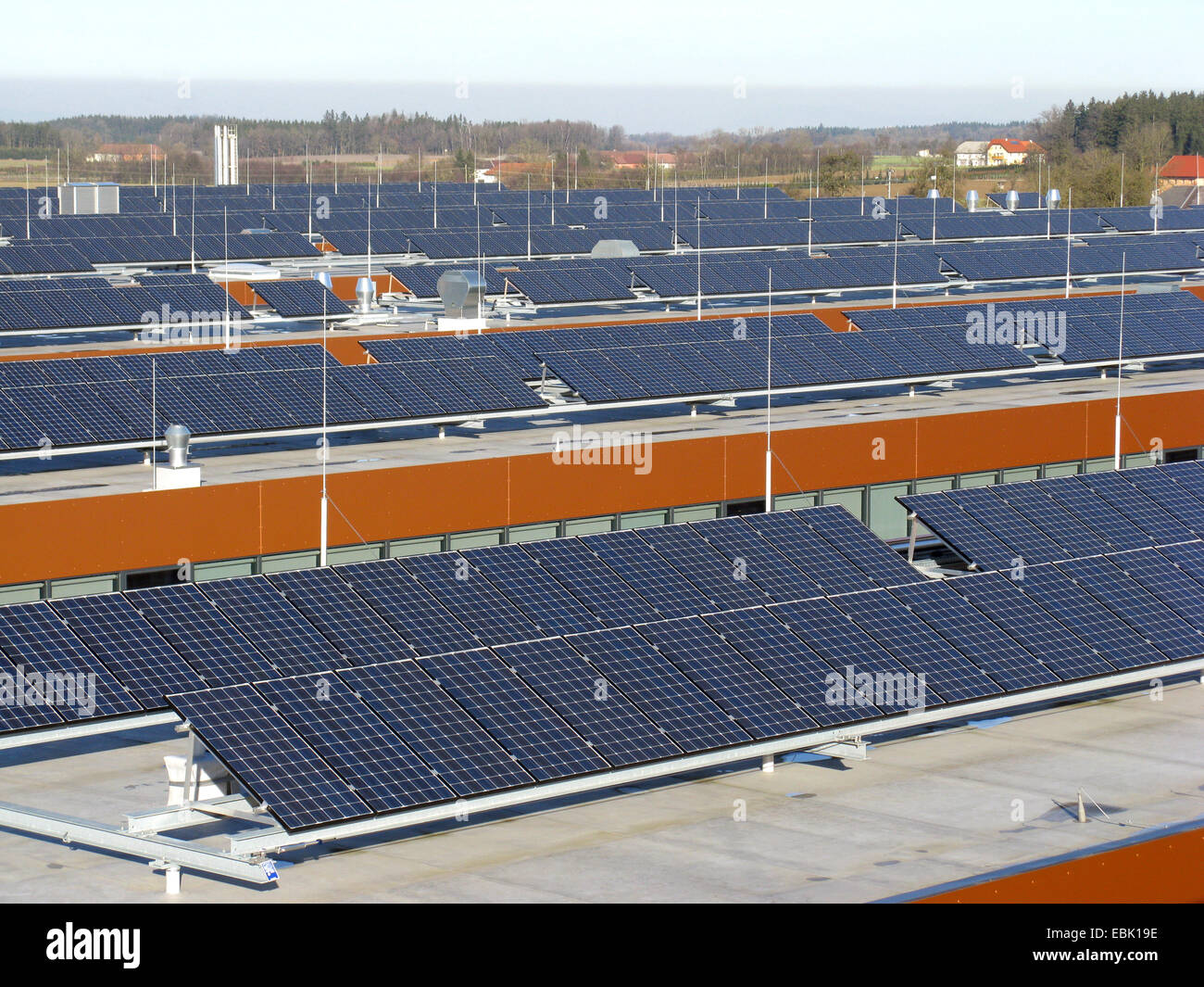 large roof with photovoltaic systems in an enterprise - Stock Image