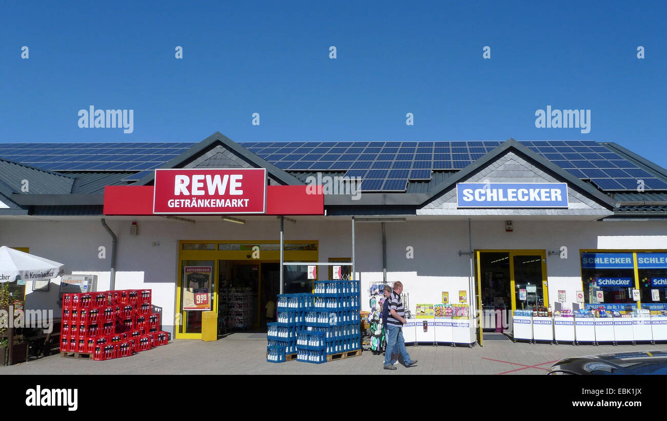 beverage store of a supermarket chain and branch of a chemist's chain under one roof, Germany - Stock Image