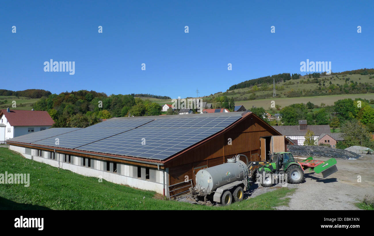 solar panels on the roof of a farm building, Germany - Stock Image