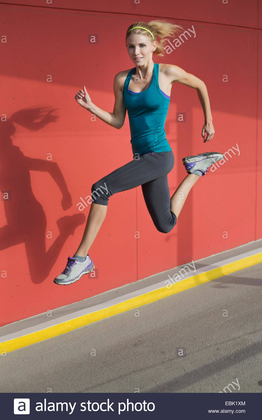 Young woman leaping - Stock Image