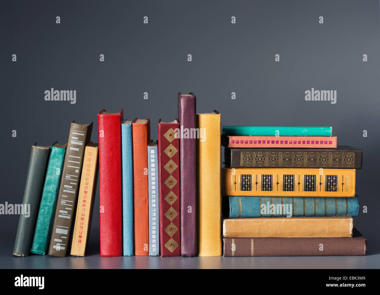 Books on a dark background - Stock Image