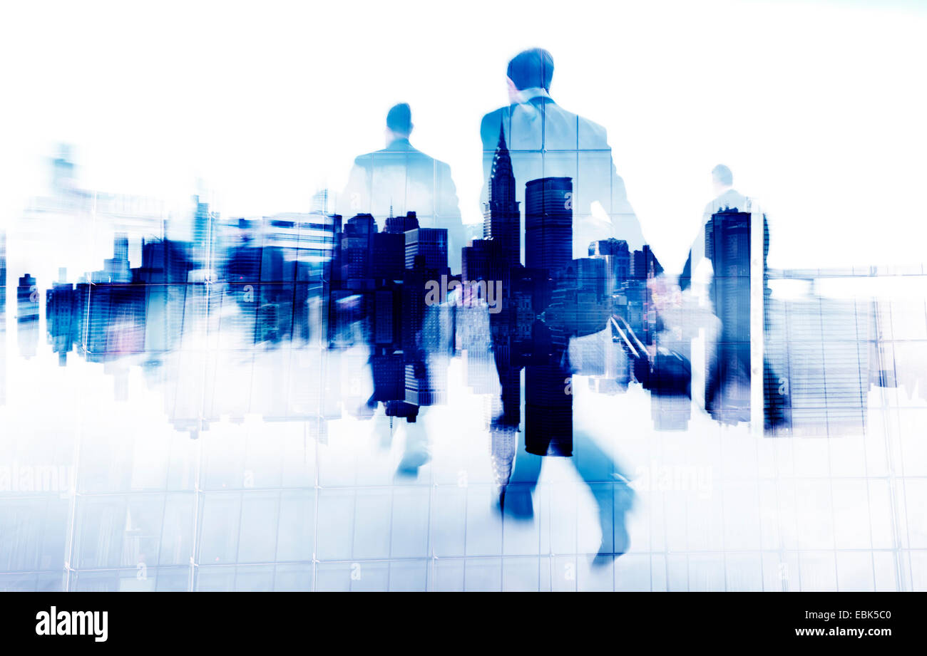 Business People Walking on a City Scape - Stock Image