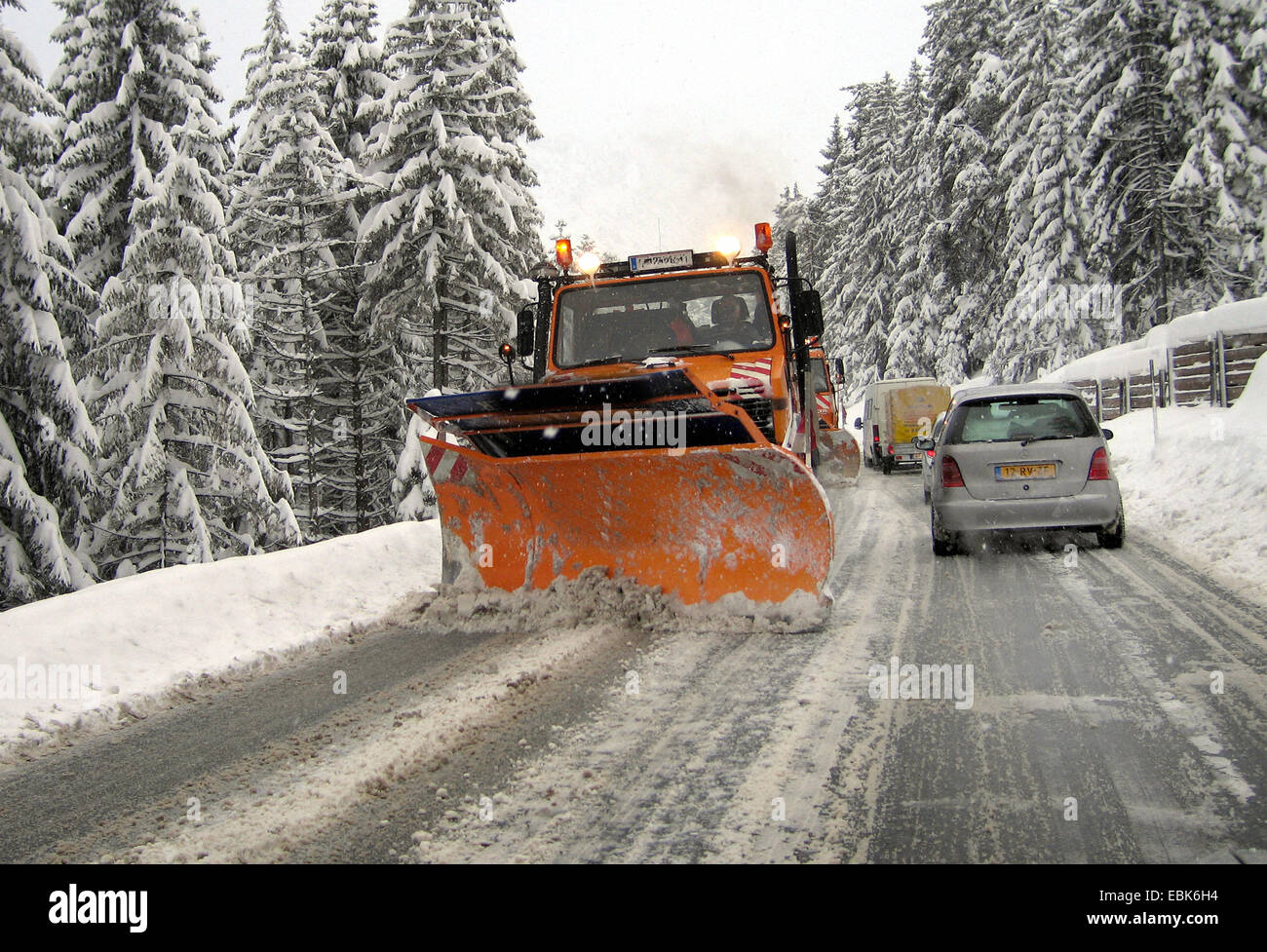 snowplow on winterly country road - Stock Image