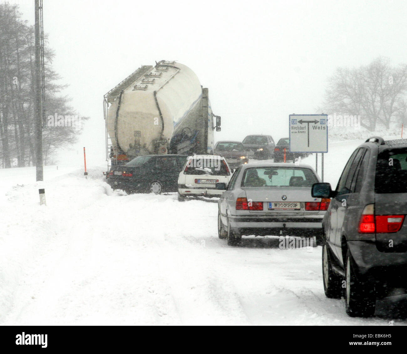 traffic chaos on a snow covered road with fresh snow - Stock Image
