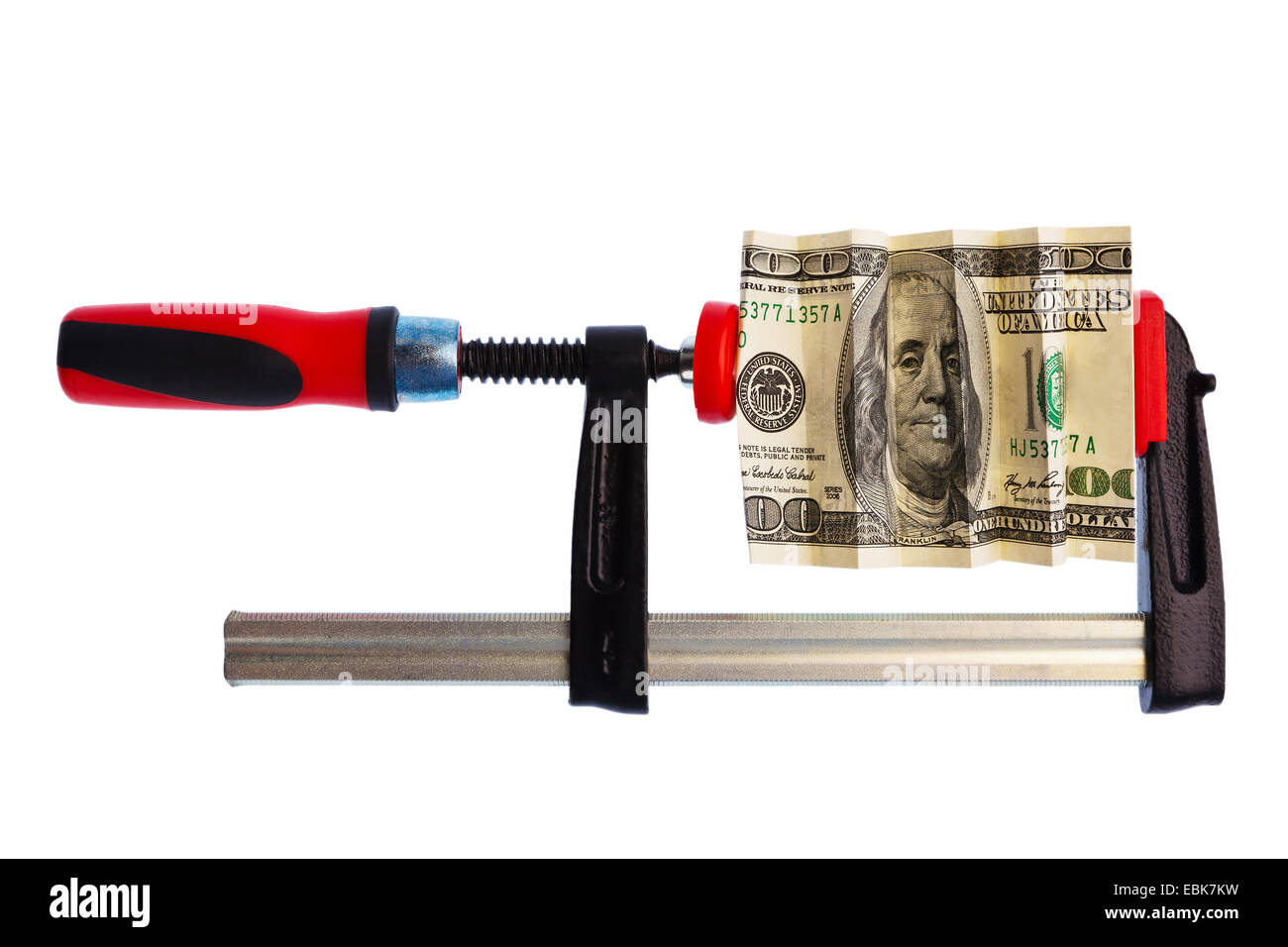 Dollar bill in a clamp, economic and financial crisis - Stock Image
