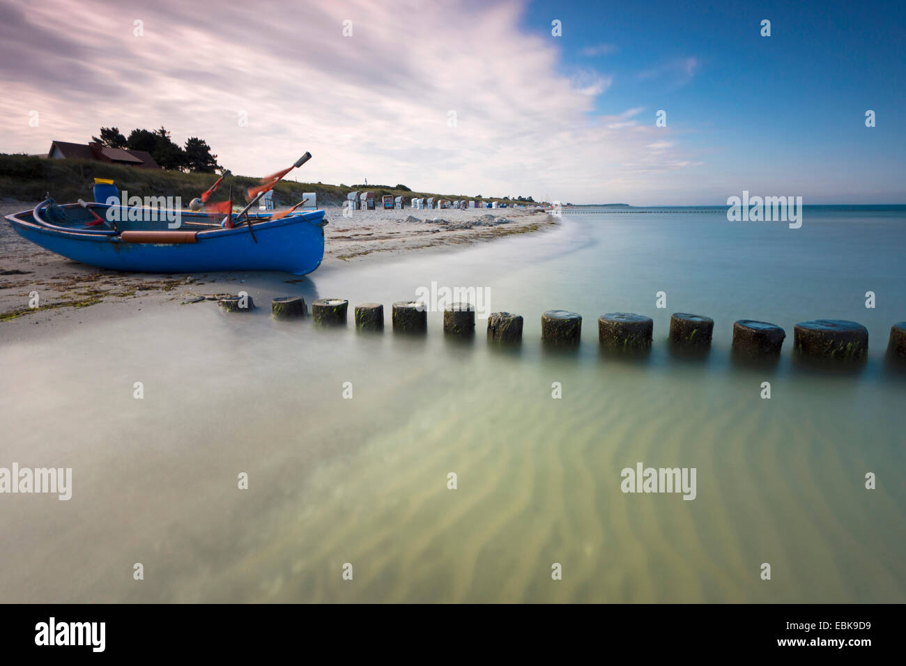 fishing boat and spur dike at Baltic Sea in morning light, longtime exposure, Germany, Mecklenburg-Western Pomerania, - Stock Image