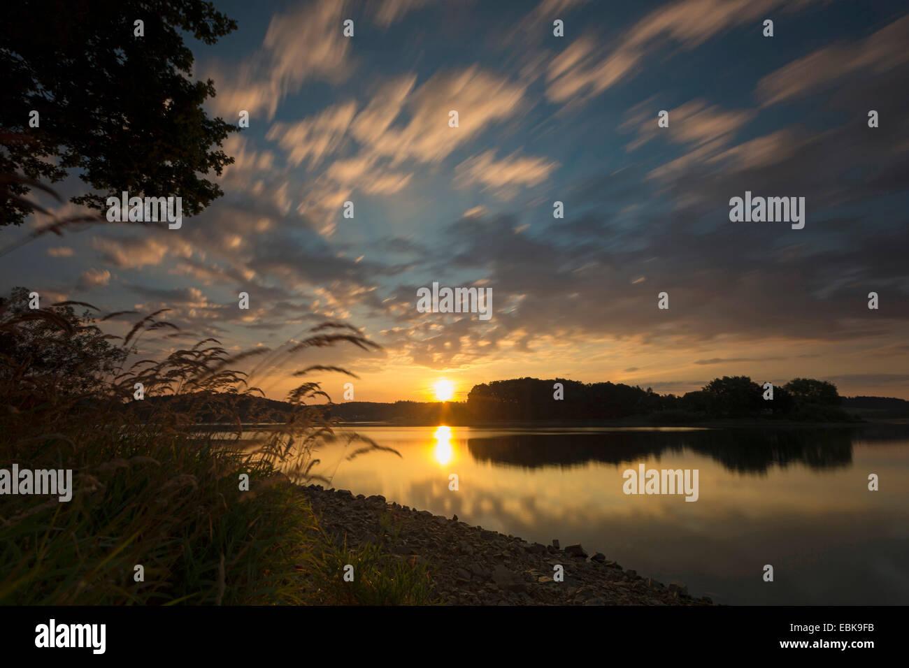 moving clouds over a lake, longtime exposure, Germany, Saxony, Vogtlaendische Schweiz, Jocketa, Vogtland - Stock Image